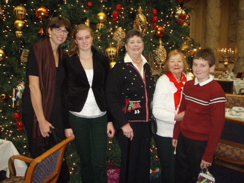 UWA members and children in front of christmas tree